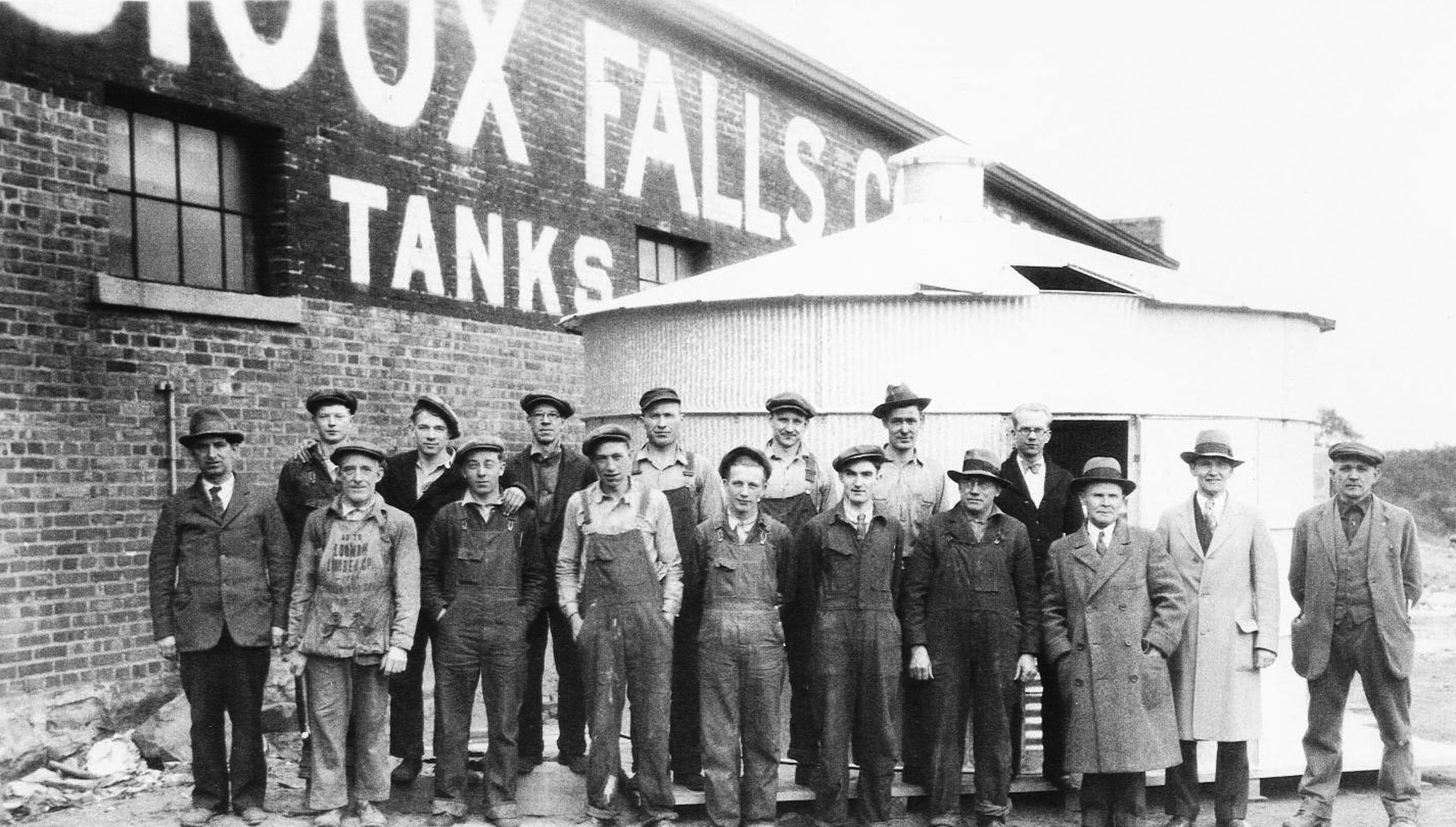 Sioux Steel factory workers & employees with owners Charles & Max Rysdon (third and second from the right).